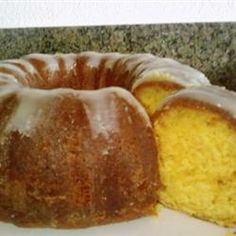 """Golden Rum Cake Allrecipes.com (uses yellow cake mix, vanilla pudding mix, great reviews, read advice on types of rum.  One reviewer said """"For the cake: (1) Use milk instead of water in the cake mix. (2) Used pecans instead of walnuts. (3) Baked for 50 minutes instead of 60. (4) Sifted the cake and pudding mix together. For the glaze: (1) Used 1/2 amount of rum (2) Boiled the glaze for a couple of minutes after adding rum."""" Or add a frosting and omit nuts like in the picture)"""