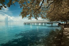 Wooden dock of Liang Beach, one of the most beautiful beaches in Indonesia, Ambon, Maluku.