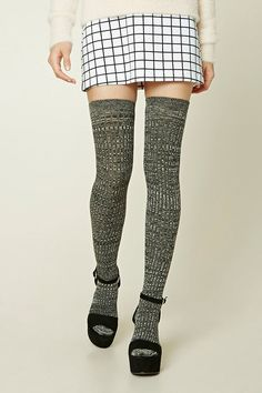 A pair of ribbed marled knit socks featuring an over-the-knee design.