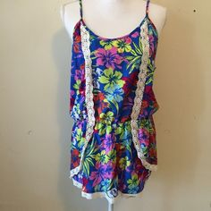 Harmony & Havoc Hawaiian Floral Romper Fun and flirty romper with Hawaiian floral print and crochet/lace detailing down front. Adjustable shoulder straps. Great condition! Harmony & Havoc Pants Jumpsuits & Rompers