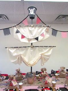 Captain Arron's Pirate Themed Birthday Party Pirate themed birthday party. Impressive ship's mast centerpiece! Perfect for a pirate party. Pirate Halloween, Pirate Day, Pirate Theme, Halloween Rocks, Halloween Costumes For Kids, Halloween Crafts, Halloween Party, Pirate Party Decorations, Pirate Party Centerpieces