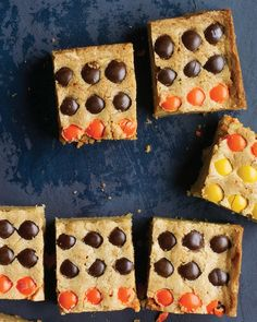 Halloween Blondies | Martha Stewart Living - Get the young ones involved in the Halloween fun. Let them sort the chocolate candies by color and arrange them on top of the dough.