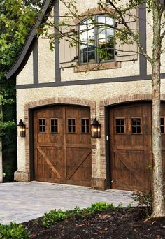 These oversized lantern style lights give this home the rustic charm that it deserves, and the garage doors are fabulous! Description from pinterest.com. I searched for this on bing.com/images