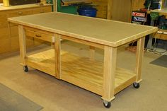 woodworking assembly table rolling but awesome 5 in workshop projects kitchen Workbench Designs, Workbench Plans, Woodworking Workbench, Woodworking Shop, Woodworking Projects, Woodworking Assembly Table, Shop Layout, Sewing Table, Sewing Rooms
