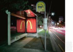 """to announce that McDonald's restaurants are now open at night, we designed an ad that could literally only be read at night... after the dark, the back-lit poster was reflected in the glass revealing the complete logo..."""