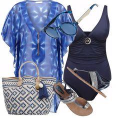 Andiamo al mare e perché no, introducendo la moda del costume intero. Costume classico ed affascinante, blu scuro. Copricostume con fantasia acquatica, sembra guardare dentro in una piscina. Occhiali tondi, blu, e sandali blu. Non dimentichiamo borsetta porta tutto in blu e sabbia.