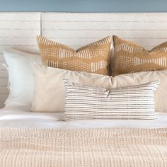 This cream and black lumbar pillow has a beautiful textured stripe and hand-loomed appearance, elevating an otherwise basic stripe into a thing of beauty. Equal parts crisp and tailored, yet casual and eclectic, it's the perfect piece to layer into any pillow-scape.