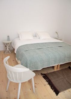 Clean, simple, bright bedroom.  I'd love to find dining chairs like this.