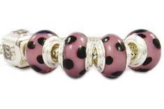 dalmatian glass beads with lilac motif.
