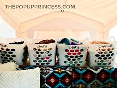 Each family member gets a flexible laundry basket to pack camping essentials. The baskets can be moved around easily while at the campground. #campinghacks #camping #popupcamper #glamping #familycamping #campingwithkids