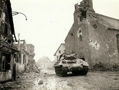 An M-10 Tank Destroyer from the 636th Tank Destroyer Battalion supporting the 143rd Infantry Regiment, 36th Division in Rohrwiller, 4 February 1945. Notice the extensive damage to the town's church, which was likely damaged by shell blasts.