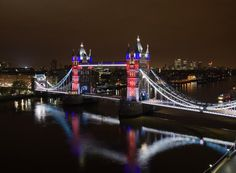 A night-time shot of London's Tower Bridge, which was re-lamped with GE LED lights and metres of GE LED linear lights in advance of the 2012 Olympic Games. Waterloo Bridge, Millennium Bridge, Famous Bridges, Tower Bridge London, London Landmarks, Night City, London Calling, Architecture, Places To Go