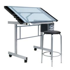 """This two-piece set includes Studio Designs' Vision Craft Station and Stool. The Vision Craft Station is the ideal table for artists and draftsmen. It features a large work surface (35.5"""" x 24"""" D) made of tempered blue safety glass. The angle of the table top adjusts up to 70... more details available at https://furniture.bestselleroutlets.com/home-office-furniture/drafting-tables/product-review-for-vision-2pc-craft-center-silver-blue-glass/"""