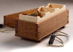Just a simple dovetailed box with a rope to keep it closed.