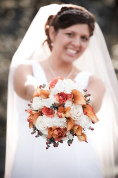 The gorgeous bride holding her bouquet for a bit of bouquet glam.