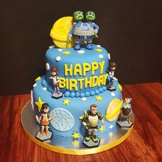 Miles From Tomorrowland cake by Cakes by Zoie