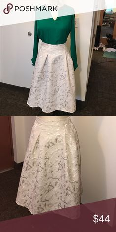 """Gorgeous gold brocade midi skirt! Size 4 This skirt is seriously gorgeous. It's the perfect midi length and has only been worn once! The tag inside says size small, the waistband measures at 26 1/2"""", so approximately a size 4. It was purchased at Nordstrom. Skirts Midi"""