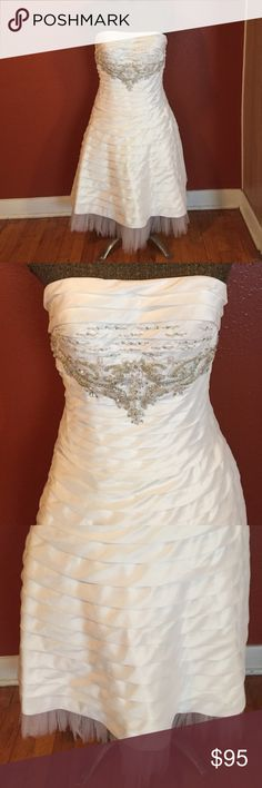 Beautiful White & Crystal Encrusted Dress. Size M Beautiful White & Crystal Encrusted Dress. Size Medium.   Brand is Fiesta. Tulle trim on bottom. Gown is 100% polyester. Beautiful pleated design. Tea length dress. Would work great as a wedding dress for someone or a great party dress.  NWOT. Fiesta Dresses Strapless