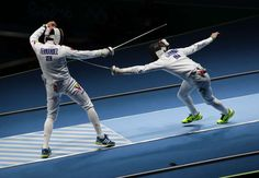 Best images from Aug. 14 at the Rio Olympics:      Silvio Fernandez of Venezuela competes against Alexandre Camargo of Brazil during the men's team epee fencing last 16 in the Rio 2016 Summer Olympic Games at Carioca Arena 3.