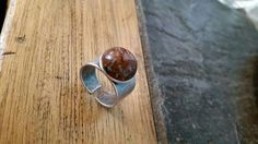Metal ring with poppy jaspis precious stone