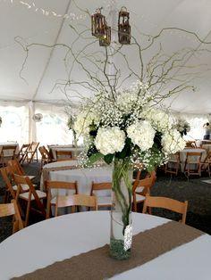 Tall white wedding centerpiece with babys breath white hydrangea | Williamsburg Floral