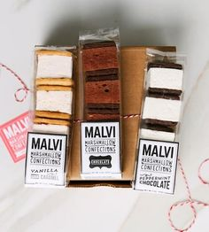 Black & White Marshmallow Sandwich Assortment by Malvi ~ . The shortbread style cookies are made with things like gourmet dark chocolate, while the 'mallows are made with molten sugar fluff, carefully carved into cubes. $16.00 for 12 pieces.