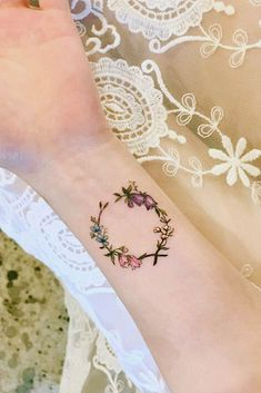 33 Delicate Wrist Tattoos For Your Upcoming Ink Session : Floral Wreath Tattoo Idea ★ Small but meaningful wrist tattoos designs can be explored here. Pick a tiny rose flower or vital words, or some other cute feminine tattoo. Unique Wrist Tattoos, Unique Tattoos For Women, Meaningful Wrist Tattoos, Cute Tattoos On Wrist, Flower Wrist Tattoos, Tattoo Designs Wrist, Wrist Tattoos For Women, Small Tattoos, Small Feminine Tattoos
