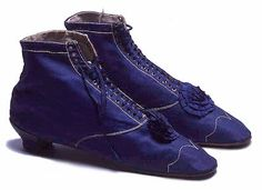Women's evening boots, 1865.  Royal blue cotton sateen boots with white stitching and trimmed with blue slik rosettes.  Length: 24 cm