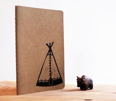 Tipi Blank Moleskine Journal Notebook - Pocket Size - Hand Carved Stamp. $10.00, via Etsy.