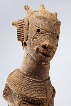 Nok sculpture of a head, Nigeria, c. 500BC-200AD (terracotta)