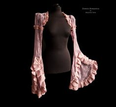 Item:  This romantic bolero or shrug is made of heather pink lace fabric, decorated with lots of heather pink lace. Its fit to be combined into