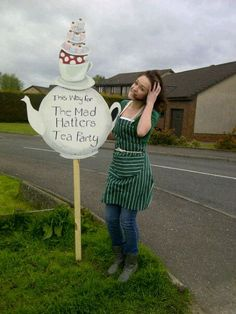 Sign for Mad Hatters Tea Party Fundraiser for The Maggies Centre (and me in a pinny not looking very cool)
