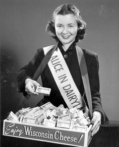 """Margaret McGuire is named the first """"Alice in Dairyland"""" (to promote Wisconsin cheese) at the WISCONSIN STATE FAIR; 1948 ."""