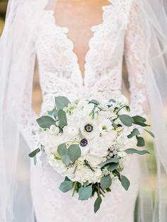 Anemone, hydrangea, ranunculus, and eucalyptus wedding bouquet: Photography: Amy Arrington Photography - www.amyarrington.com   Read More on SMP: http://www.stylemepretty.com/2016/11/15//