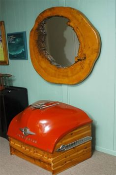 Trunk from a car trunk. Love the natural edge wood mirror, too!!!