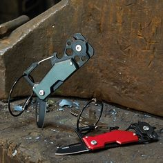 Mini tool with 10 functions, knife, keyring (wire loop) with carabiner, bottle opener, 3 screwdrivers (2 Phillips, 2 slotted), Allen key (4 sizes), small pry bar, ruler (5 cm), spoke wrench (spoke tool), stainless steel and anodized aluminum, in titanium colour and red. Key Organizer, Ruler, Bottle Opener, Wire, Canada, Stainless Steel, Colour, Tools, Color