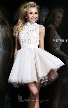 Look and feel like a hollywood star with Sherri Hill 21345, part of the Sadie Robertson by Sherri Hill collection. This sparkling short mini offers a high neckline with sleeveless top. Fully embellished bodice is cut with an open back detailing. The short mini dress flares on the waist for added volume.