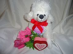 Valentines 11 Inch White Poodle with Pink Roses Heart & S... https://www.amazon.com/dp/B01NBSBBSK/ref=cm_sw_r_pi_dp_x_qmwEybWRRGEKY