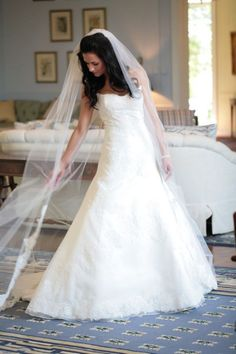 Love the dress, her hair and the veil.