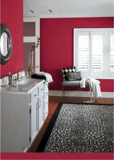 Red bathroom...love the color with that rug! (Sherwin-Williams Antique Red SW 7587)