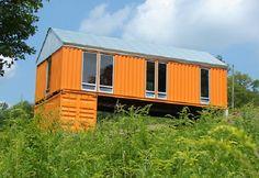 elevated orange container home