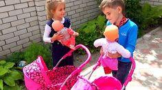 Little Girl Pushing Pink Stroller in Shopping Centre 2 - YouTube