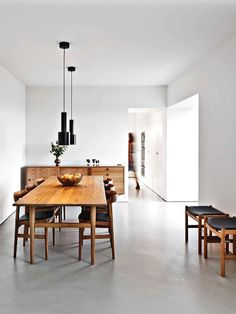 White clean minimalist dining room, love the concrete floor