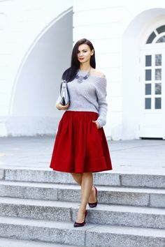 A grey cropped sweater and a red full skirt will showcase your sartorial self. For footwear go down the classic route with dark red suede pumps.   Shop this look on Lookastic: https://lookastic.com/women/looks/cropped-sweater-full-skirt-pumps/13987   — Silver Necklace  — Grey Leather Crossbody Bag  — Grey Cropped Sweater  — Red Full Skirt  — Burgundy Suede Pumps