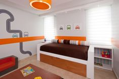 Stylish toddler bedroom with cars and roads wall decal and beautiful bedding