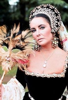 """Richard Burton purchased the pearl at the Sotheby's auction for $37,000. He gave it to his wife Elizabeth Taylor as a Valentine's Day gift during their first marriage. Taylor wore the pearl in her cameo in """"Anne of a Thousand Days"""", a movie about Anne Boleyn, which starred her husband, Richard Burton, as King Henry VIII."""