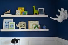 Love the simple styling of this nursery shelf.