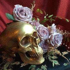 Golden skull with flowers
