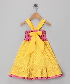 This groovy, girly frock stays snug thanks to stretchy shirring on the bodice and no-slip straps, while a lively mix of prints and a big bow in front add unique charm that's perfectly suited for budding style stars.100% cottonMachine wash; tumble dryImported