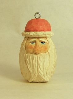 This is a hand carved Santa Christmas tree decoration. Carved from basswood and painted with non-toxic acrylic paint, the Santa measures 2.5